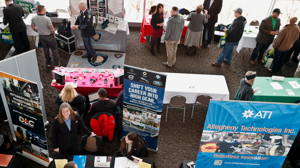 FILE- In this March 7, 2019, file photo visitors to the Pittsburgh veterans job fair meet with recruiters at Heinz Field in Pittsburgh. On Tuesday, April 10, the Labor Department reports on job openings and labor turnover for February. (AP Photo/Keith Srakocic, File)