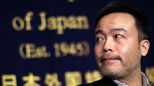 FILE - In this Jan. 22, 2015, file photo, Kosuke Tsuneoka, a Japanese freelance journalist, looks on before a news conference at the Foreign Correspondents' Club of Japan in Tokyo. The journalist Tuneoka known for covering war zones has sued the Foreign Ministry after it invalidated his passport and demanded he surrender it, saying it deprives him of his right to travel and interferes with press freedom. (AP Photo/Eugene Hoshiko, File)