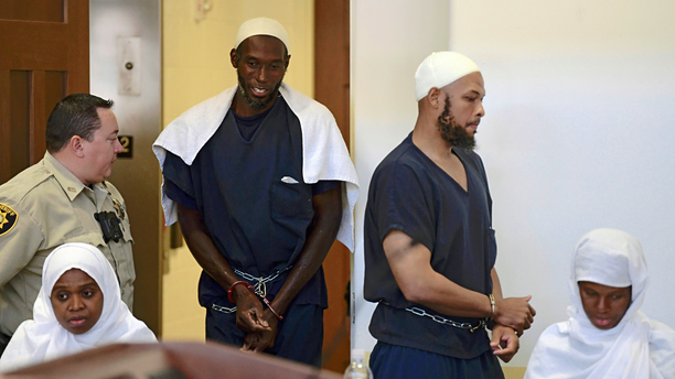 FILE - This Aug. 13, 2018 pool file photo shows defendants, from left, Jany Leveille, Lucas Morton, Siraj Ibn Wahhaj and Subbannah Wahhaj entering district court in Taos, N.M. U.S. prosecutors will not seek the death penalty against the four adults who lived at a New Mexico compound where authorities found the remains of a toddler who was reported missing in Georgia, court documents say. (Roberto E. Rosales/The Albuquerque Journal via AP, Pool, File)