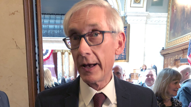 """Wisconsin Gov. Tony Evers tells reporters that the Republican Senate leader is """"huffing and puffing"""" for saying confirmation of Evers' Cabinet secretaries is in jeopardy because of an ongoing legal fight over a lame-duck legislative session on Tuesday, April 9, 2019, in Madison, Wisconsin. (AP Photo/Scott Bauer)"""