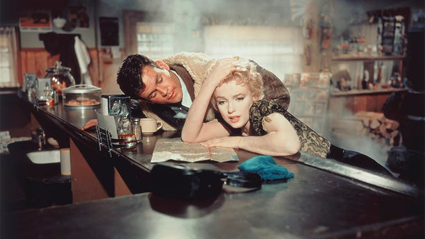 "Actors Marilyn Monroe and Don Murray on the set of ""Bus Stop,"" directed by Joshua Logan."