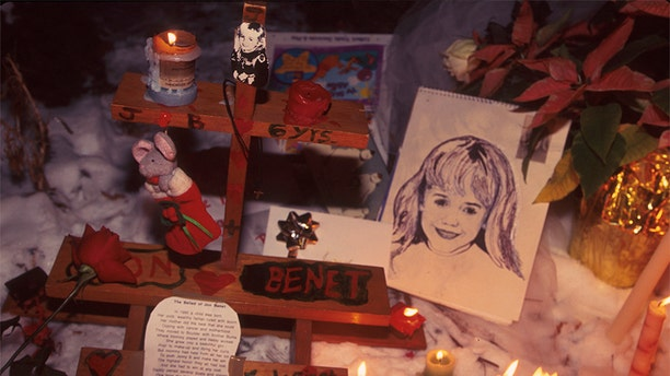 People light candles at the murder site of 6-year-old JonBenet Ramsey in Boulder, Colorado. — Photo by Karl Gehring/Liaison