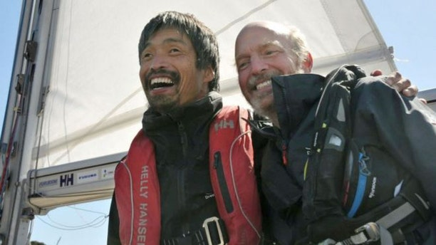 Mitsuhiro Iwamoto, a blind Japanese sailor, celebrates with his navigator Doug Smith of the U.S. after successfully completing a near two-month, non-stop voyage from San Diego to Fukushima Prefecture on the Pacific Ocean, upon their arrival at Onahama port in Iwaki, Fukushima prefecture, Japan, in this photo taken by Kyodo April 20, 2019.