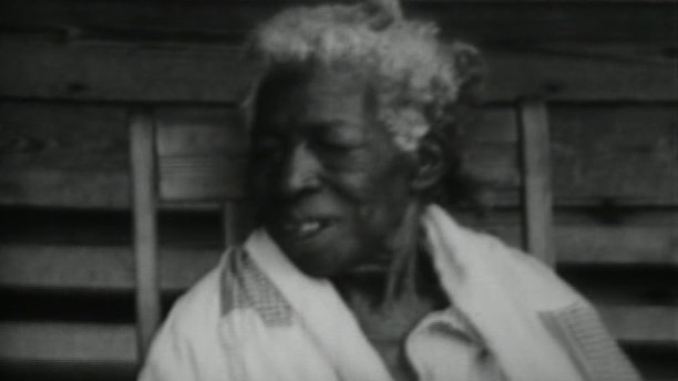 "Redoshi, described as ""Aunt Sally Smith,"" appeared briefly in a 1930s public information film entitled ""the Negro Farmer"" that was produced by the U.S. Department of Agriculture."