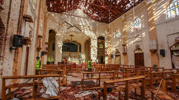 Debris inside St. Sebastian's Church after a blast in Negombo, north of Colombo, Sri Lanka, Sunday. (Associated Press)