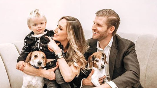 Lara and Eric Trump with their 1-year-old son Luke and their two dogs Charlie and Ben.