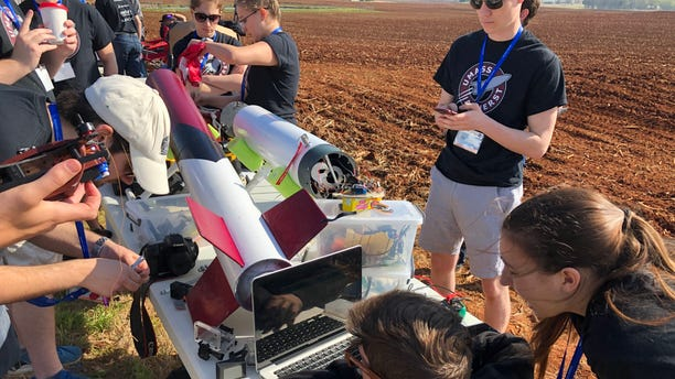 UMass Rocket Team feverishly works to troubleshoot overheating issues with its payload system ahead of its rocket launch. (Fox News/Charles Watson)