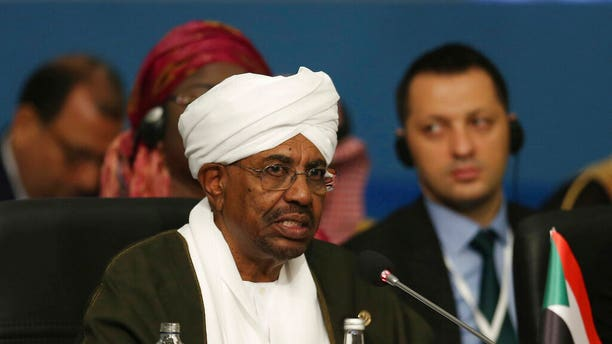 "FILE - In this May 18, 2018, file photo, Sudan's President Omar al-Bashir speaks during the extraordinary summit of the Organization of Islamic Cooperation (OIC), in Istanbul, Turkey. Sudan's armed forces were to deliver an ""important statement"" and asked the nation to ""wait for it"" on Thursday, April 11, 2019, state TV reported, as two senior officials said the military had forced longtime President Omar al-Bashir to step down.(Presidential Press Service/Pool via AP, File)"