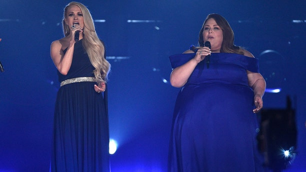 "Carrie Underwood, left, and Chrissy Metz perform ""I'm Standing with You"" at the 54th annual Academy of Country Music Awards at the MGM Grand Garden Arena on Sunday, April 7, 2019, in Las Vegas. (Photo by Chris Pizzello/Invision/AP)"