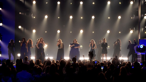 "Mickey Guyton, from left, Lauren Alaina, Carrie Underwood, Chrissy Metz, and Maddie Marlow and Tae Dye, of Maddie & Tae, perform ""I'm Standing with You"" at the 54th annual Academy of Country Music Awards at the MGM Grand Garden Arena on Sunday, April 7, 2019, in Las Vegas. (Photo by Chris Pizzello/Invision/AP)"