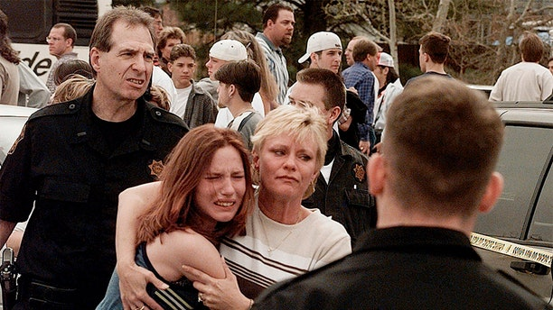 A woman embraces her daughter after they were reunited following the Columbine High School shooting. (AP/File)