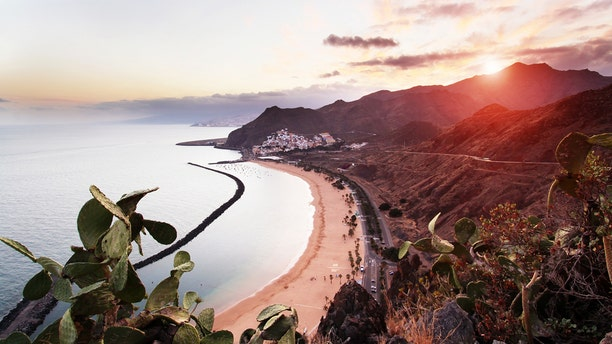 View of Playa de Las Teresitas, Sant Andres and Santa Cruz de Tenerife at sunset.