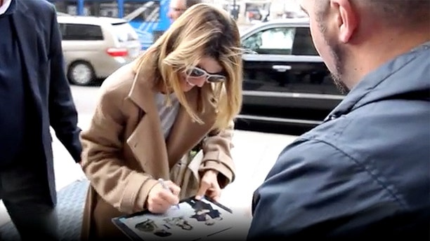 Lori Loughlin signs autographs and chats with fans the day before her court hearing in Boston for her alleged role in a nationwide college admissions scam. Loughlin and husband Mossimo Giannulli are accused of using bribes to get their daughters admitted to USC.