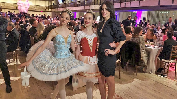 """Choreographer Melanie Hamrick poses with dancers at the gala of Youth America Grand Prix, the world's largest ballet scholarship competition, on Thursday, April 18, after the U.S. premiere of her new ballet, """"Porte Rouge"""" (Red Door), based on classic Rolling Stones tunes arranged by her partner, Mick Jagger. The Stones frontman, recovering from medical treatment, watched from backstage and addressed the audience briefly via microphone before the show. (AP Photo/Jocelyn Noveck)"""