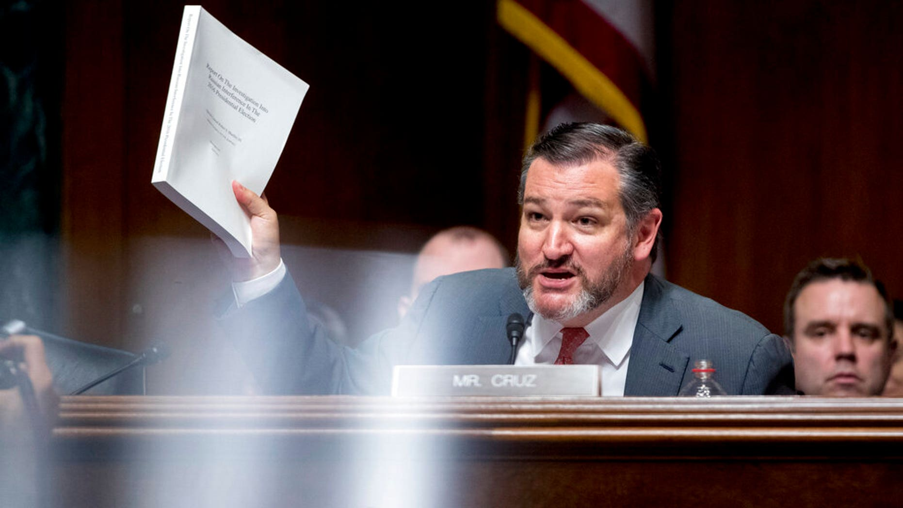 Sen. Ted Cruz, R-Texas, holds up a copy of the Mueller report as he questions Attorney General William Barr during a Senate Judiciary Committee hearing on Capitol Hill in Washington.