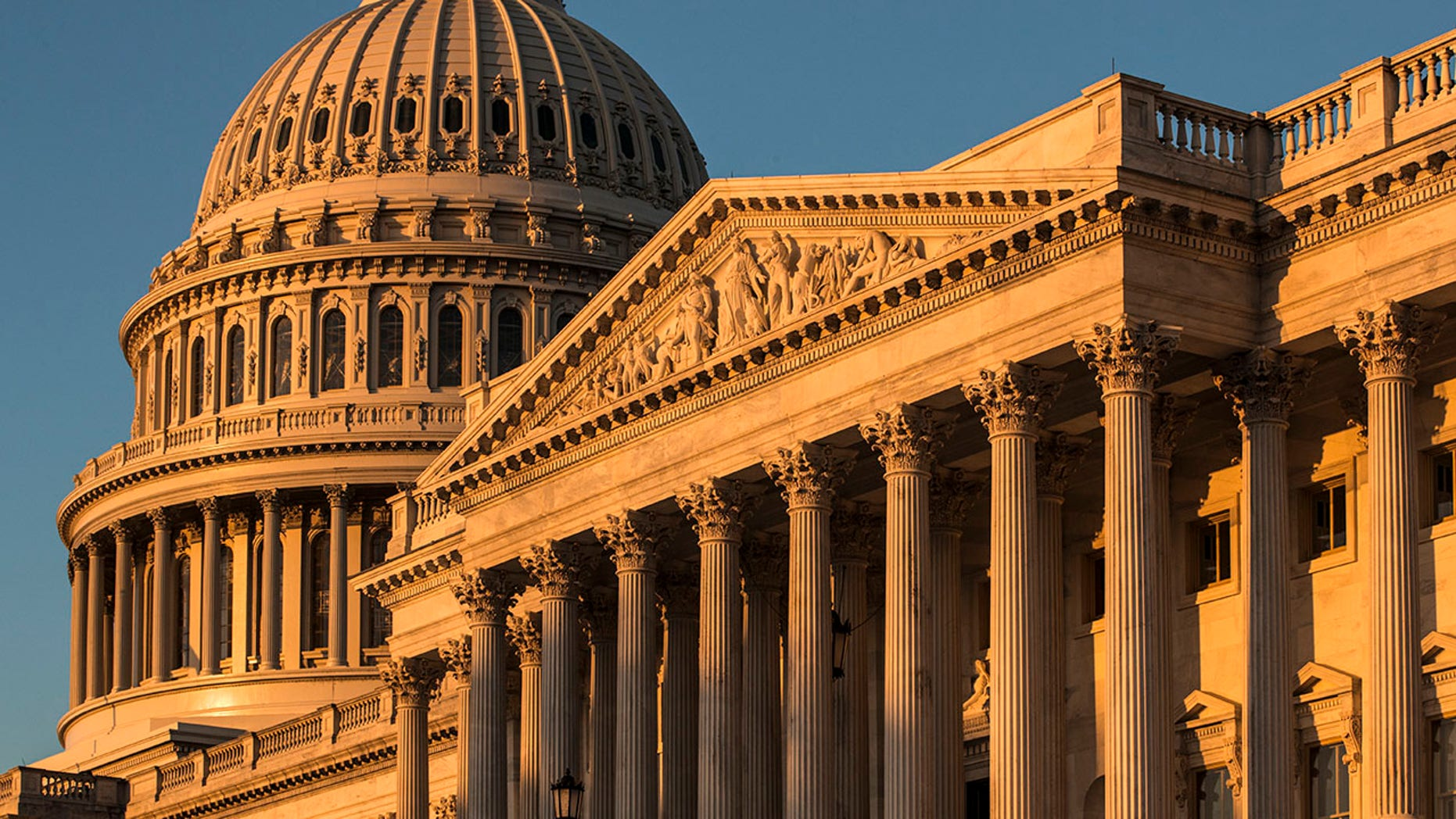 FILE - This Oct. 1, 2018, file photo, shows the Capitol at sunrise in Washington. A handful of senior House lawmakers, frustrated by more than a decade of frozen congressional salaries, are quietly exploring whether to accept an annual pay raise that they've shunned since Barack Obama was first president. (AP Photo/J. Scott Applewhite, File)