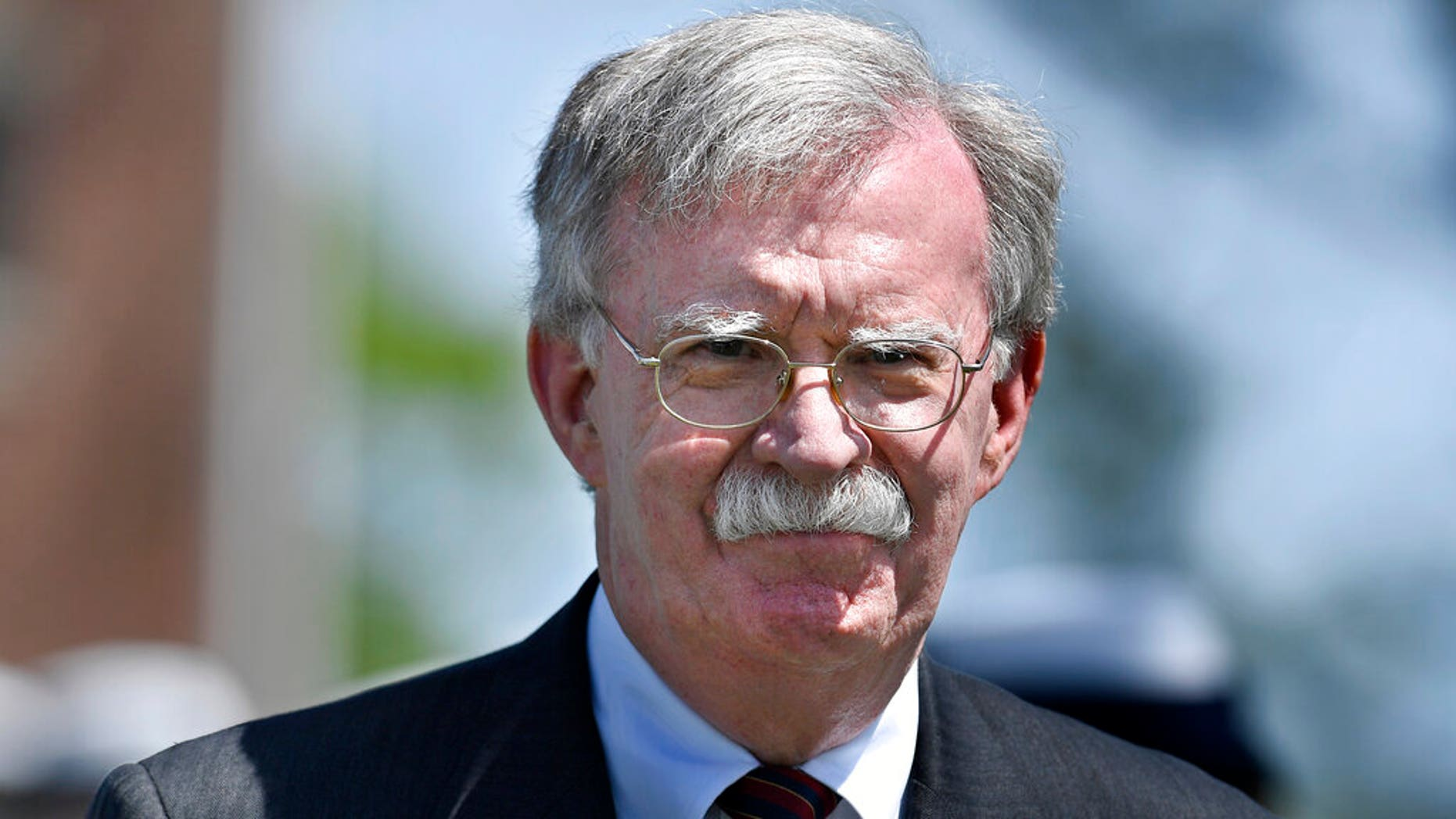 FILE: National Security Adviser John Bolton arrives to speak at the commencement for the United States Coast Guard Academy in New London, Conn.