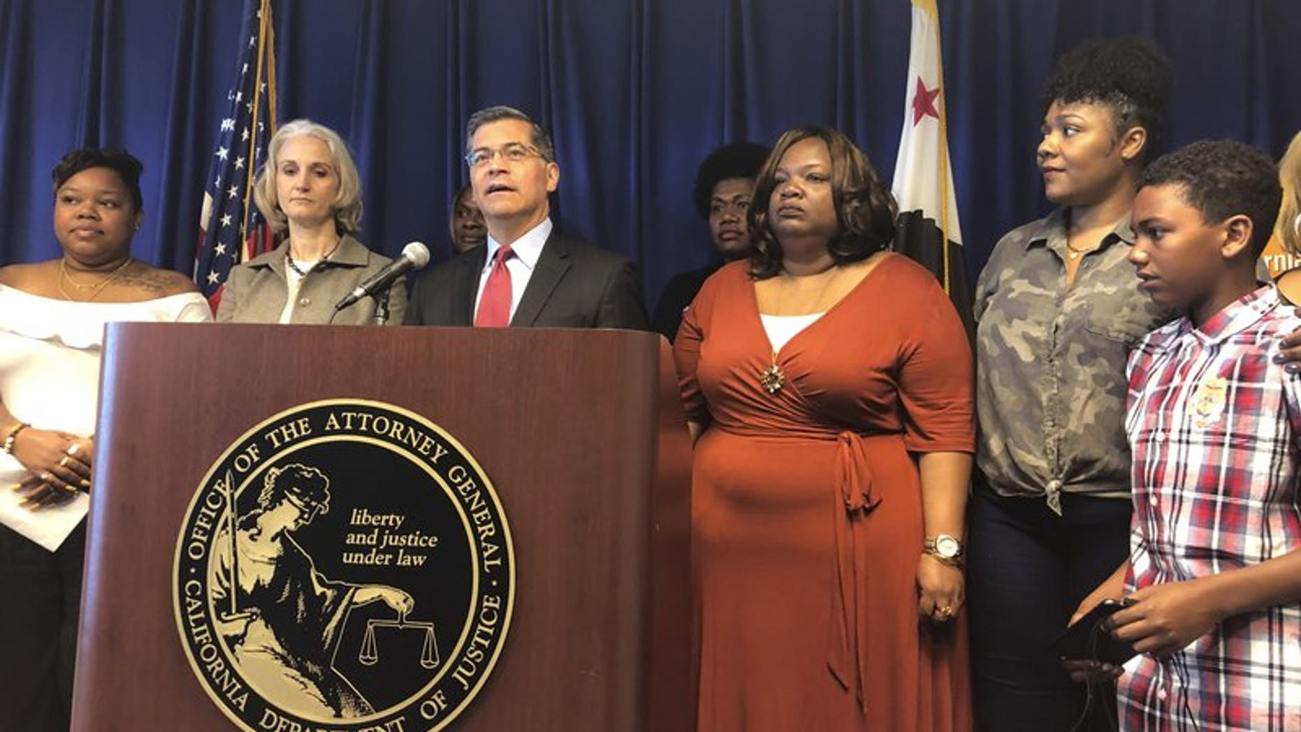 California Attorney General Xavier Becerra announces a lawsuit against the Trump Administration's new rule affecting home health care workers on Monday, May 13, 2019, in Sacramento, California.  (AP Photo/Adam Beam)