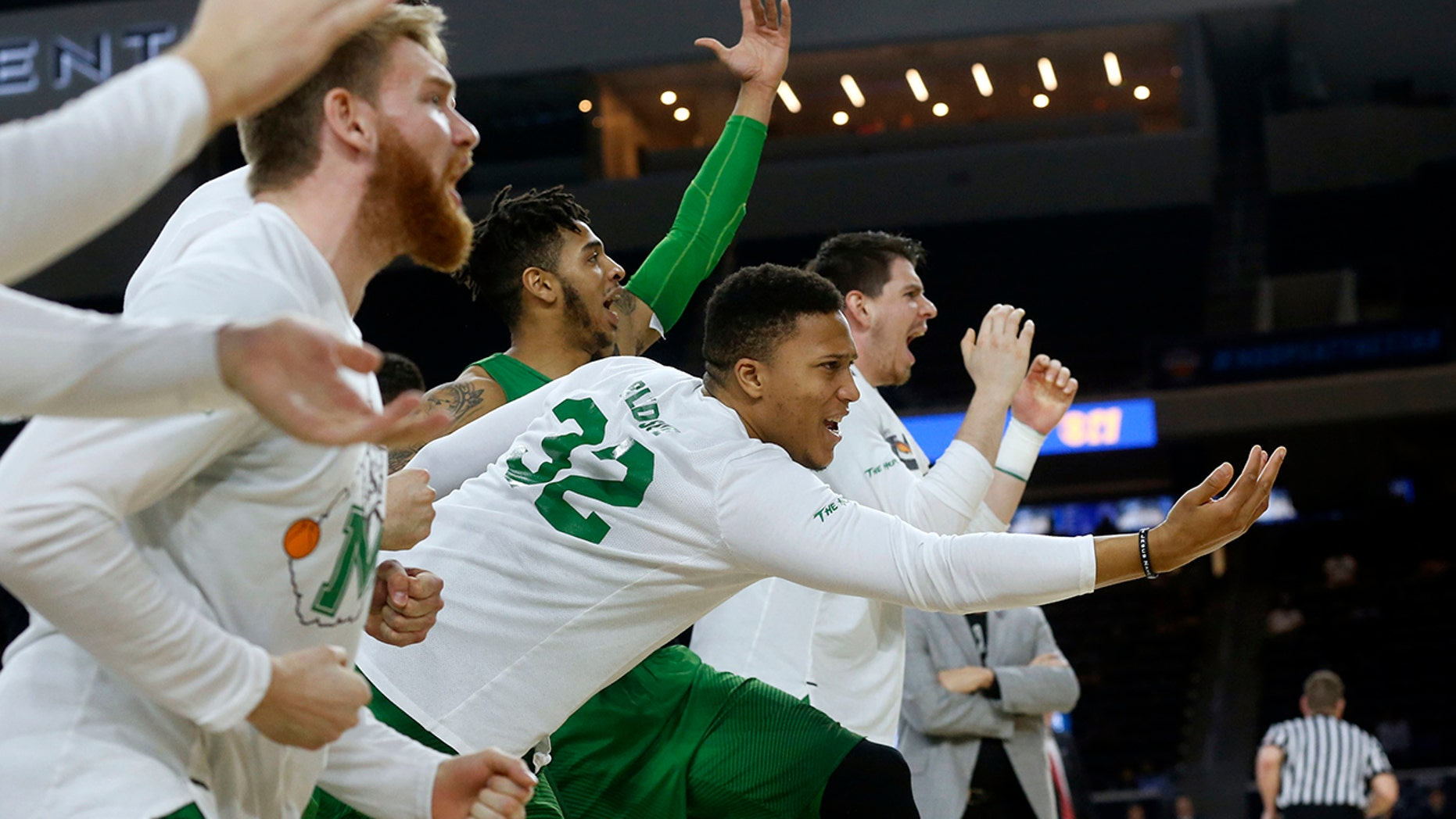 FILE - In this Saturday, March 10, 2018, file photo, then-Marshall guard Phil Bledsoe (32) and the Marshall bench react to a 3-point shot against Western Kentucky during the second half of the NCAA Conference USA basketball championship game in Frisco, Texas. (AP Photo/Michael Ainsworth, File)