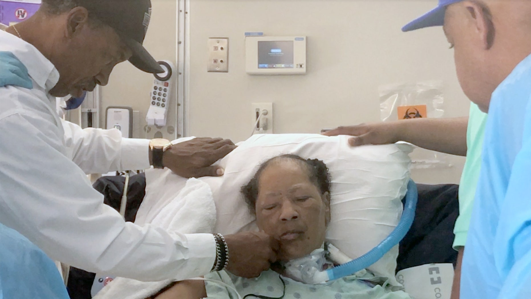 Carolyn Jones, 61, fights for her life after a Houston hospital pulled the plug against her family's wishes. Her husband of 40 years, Donald, is on her left.