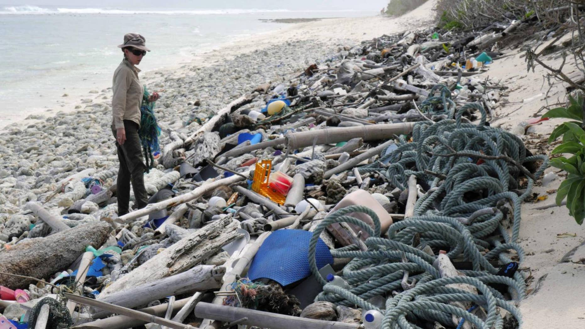 Lead author Jennifer Lavers looks out at the plastic debris covering a Cocos (Keeling) Island beach.