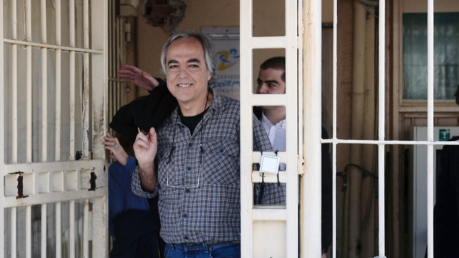 "FILE - In this Thursday, Nov. 9, 2017 file photo, Dimitris Koufodinas smiles as he leaves Korydallos prison in western Athens.  A Greek far-left extremist serving 11 life terms for a string of murders is vowing to continue ""until the end"" with a hunger strike after judges rejected his bid for new leave from prison. A lawyer representing  Koufodinas, chief hit man for the November 17 group that killed 23 people from 1975-2000, says her client will also refuse medical assistance. (Yannis Kotsiaris/InTime News via AP, file)"