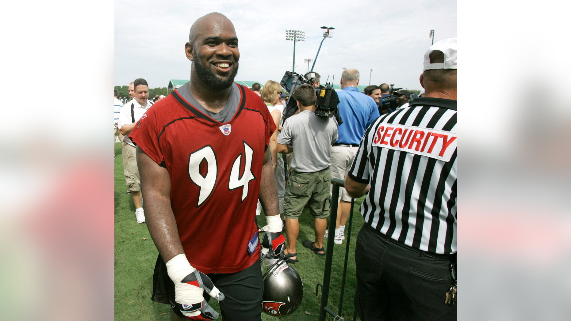 FILE - In this July 27, 2007, file photo, Tampa Bay Buccaneers defensive end Greg Spires walks off the practice field after the morning session at NFL football training camp in Lake Buena Vista, Fla. Authorities in New Hampshire say Spire, a former player for the pro football player, has been arrested in the state's capital city for violating a protective order. (AP Photo/John Raoux, File)