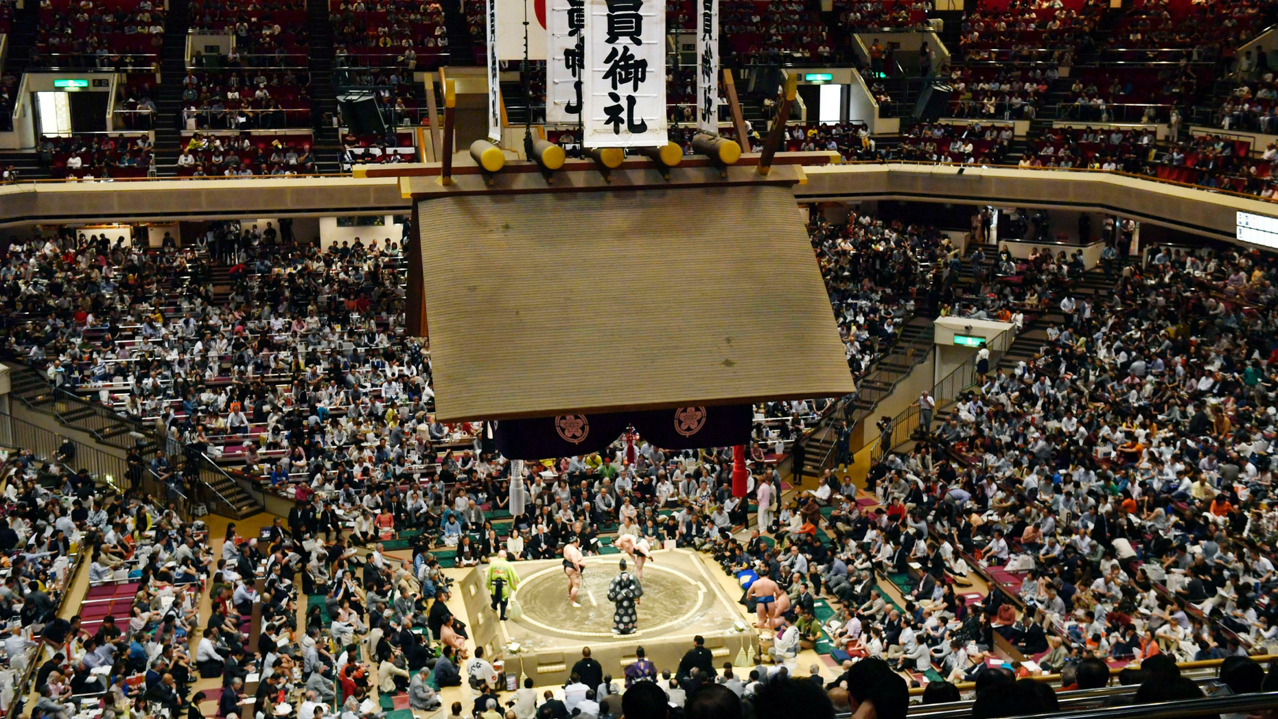 In this May 12, 2019, photo, banners thanking for a sellout crowd are displayed on the first day of Summer Grand Sumo Tournament in Tokyo. Plans for U.S. President Donald Trump to check out the ancient Japanese sport of sumo wrestling during a state visit are raising security issues for organizers. (Yoshitaka Sugawara/Kyodo News via AP)