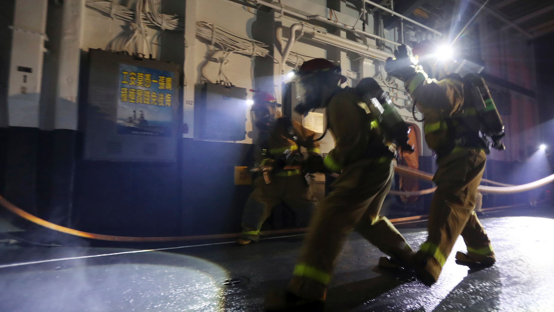 I this photo taken on Wednesday, May 21, 2019, Taiwan navy personnel simulate a fire drill inside the Knox-class frigate during an exercise in the Suao port in Yilan County, eastern Taiwan. (AP Photo/Chiang Ying-ying)