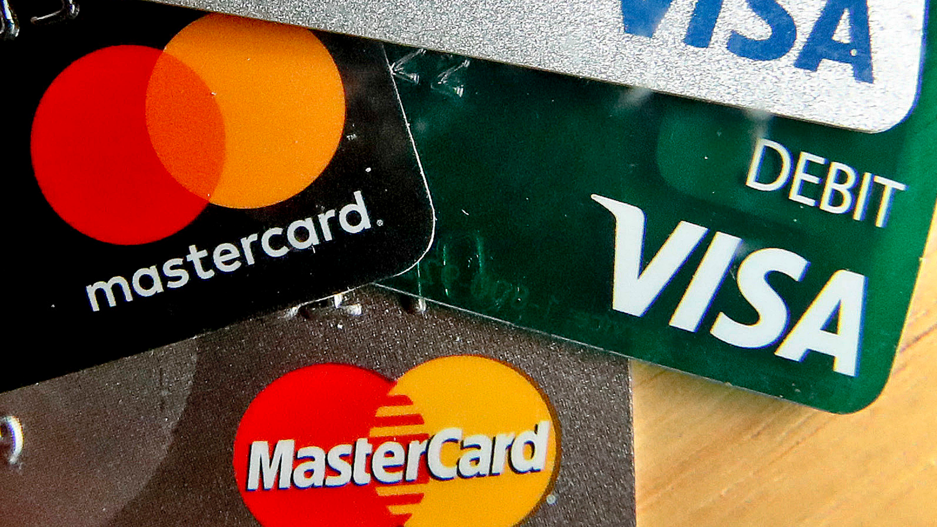 In this Feb. 20, 2019, logos for credit cards are visible on the cards in Zelienople, Pa. On Tuesday, May 7, the Federal Reserve releases its March report on consumer borrowing. (AP Photo/Keith Srakocic)