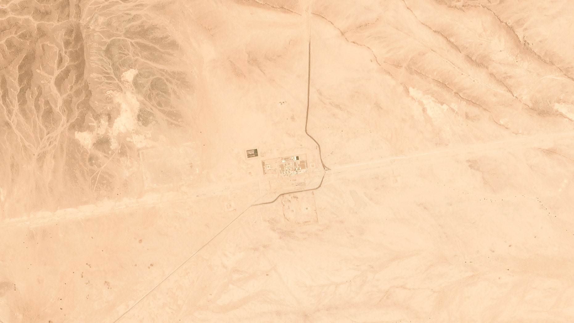 This satellite image provided by Planet Labs Inc. shows Saudi Aramco's Pumping Station No. 8 near al-Duadmi, Saudi Arabia, Tuesday, May 14, 2019, after what the kingdom described as a drone attack on the facility. An oil pipeline that runs across Saudi Arabia was hit Tuesday by drones, the Saudi energy minister said, as regional tensions flared just days after what the kingdom called an attack on two of its oil tankers elsewhere in the Mideast. (Satellite image © 2019 Planet Labs Inc. via AP)