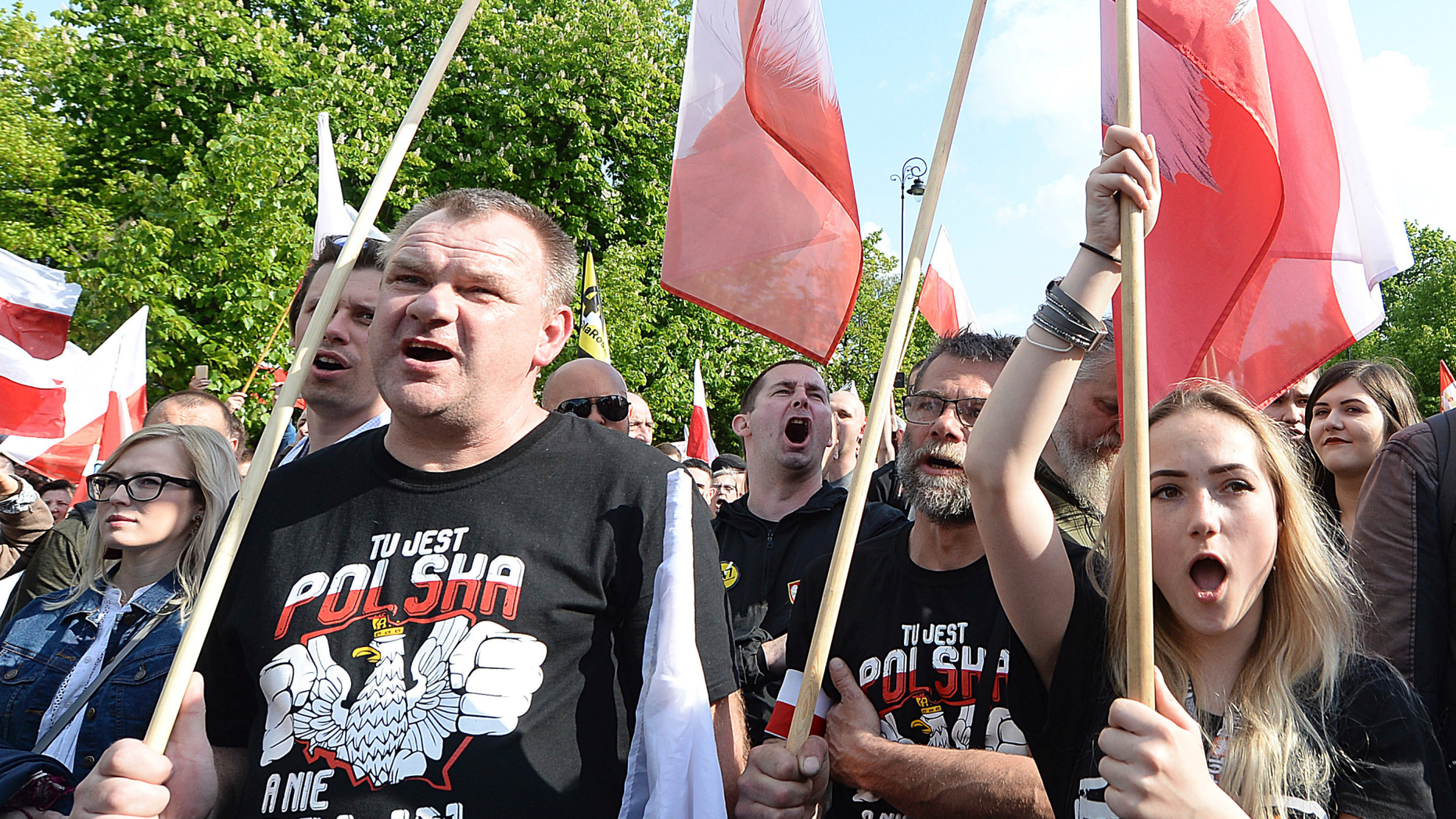 """Thousands of Polish nationalists march to the U.S. Embassy, in Warsaw, Poland, Saturday, May 11, 2019. Thousands of Polish nationalists have marched to the U.S. Embassy in Warsaw, protesting that the U.S. is putting pressure on Poland to compensate Jews whose families lost property during the Holocaust. The protesters included far-right groups and their supporters. They said the United States has no right to interfere in Polish affairs and that the U.S. government is putting """"Jewish interests"""" over the interests of Poland. The T-shirts read in Polish """"This is Poland not Polin"""" (AP Photo/Czarek Sokolowski)"""