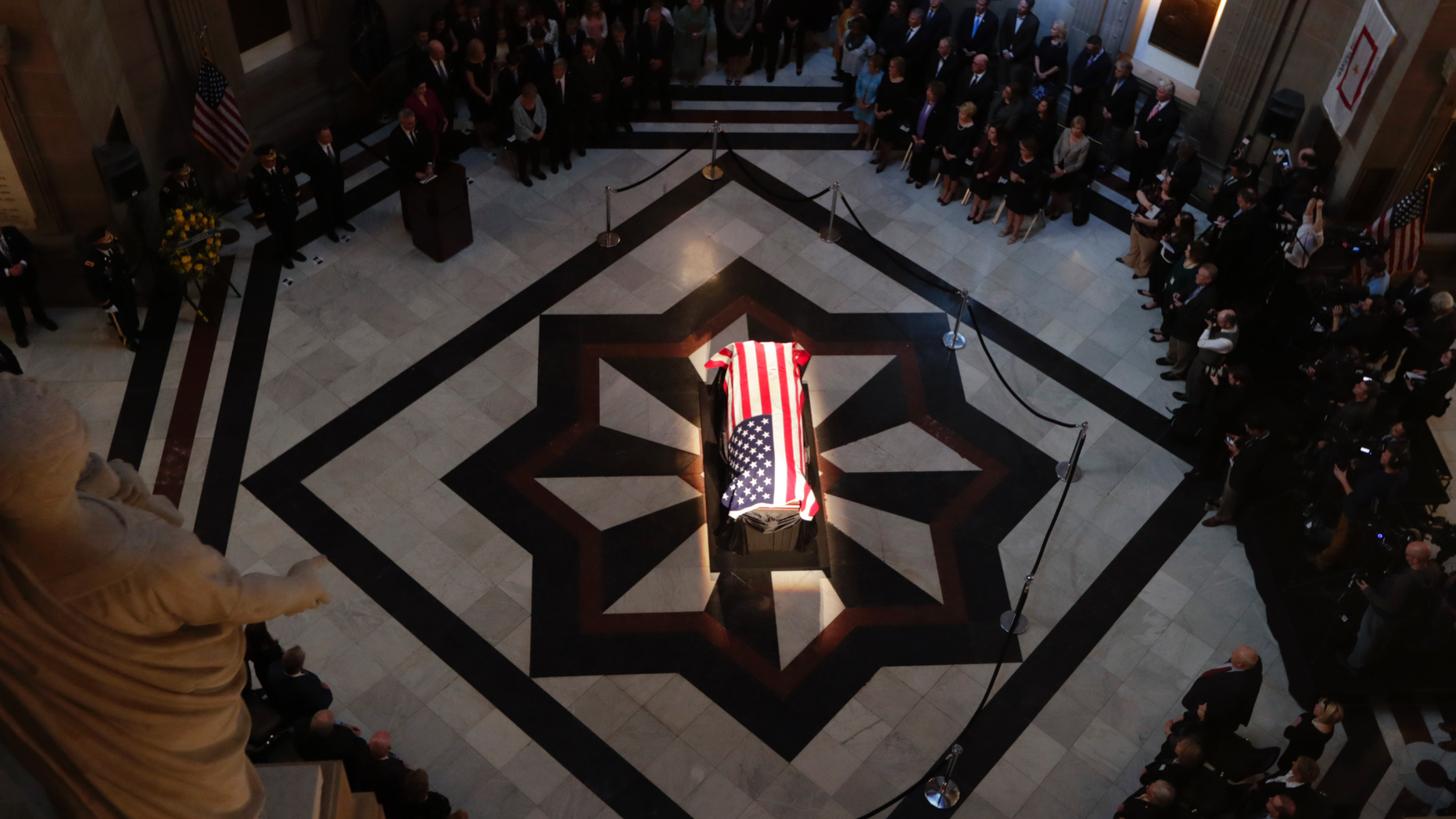 """The casket of Sen. Richard Lugar is illuminated in the Indiana Statehouse rotunda in Indianapolis, Tuesday, May 14, 2019. Lugar was a longtime Republican senator and former Indianapolis mayor who's been hailed as an """"American statesman"""" since he died April 28 at age 87. (AP Photo/Michael Conroy)"""