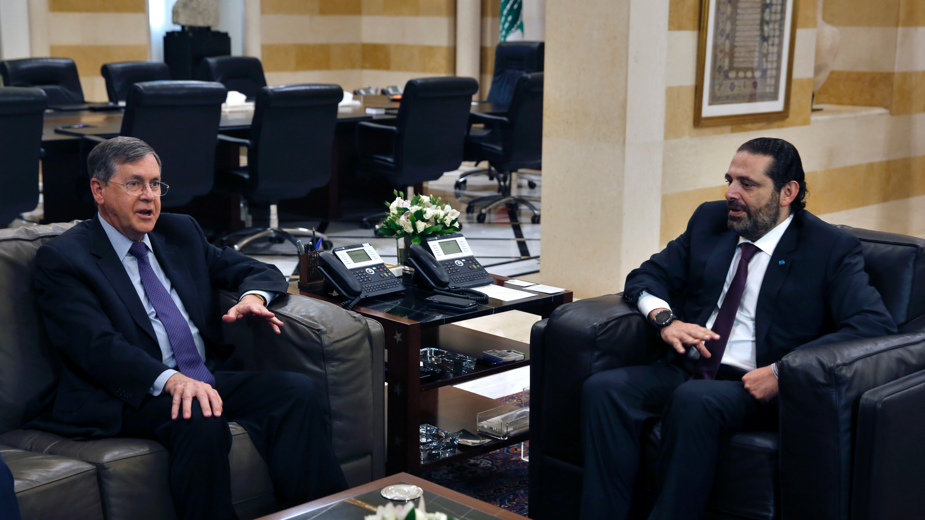 """U.S. Deputy Assistant Secretary of State David Satterfield, left, speaks during his meeting with Lebanese Prime Minister Saad Hariri, in Beirut, Lebanon, Tuesday, May 14, 2019. Satterfield's visit comes a week after President Michel Aoun presented the U.S. ambassador to Lebanon with a """"unified stance"""" regarding the demarcation of maritime border between Lebanon and Israel. (AP Photo/Bilal Hussein)"""