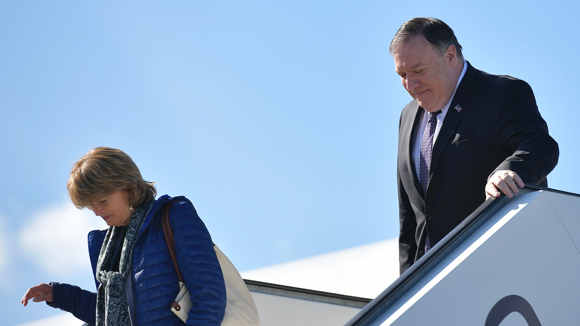 Secretary of State Mike Pompeo and Sen. Lisa Murkowski, R-Alaska, steps off a plane upon arrival in Rovaniemi, Finland, Monday, May 6, 2019. (Mandel Ngan/Pool Photo via AP)
