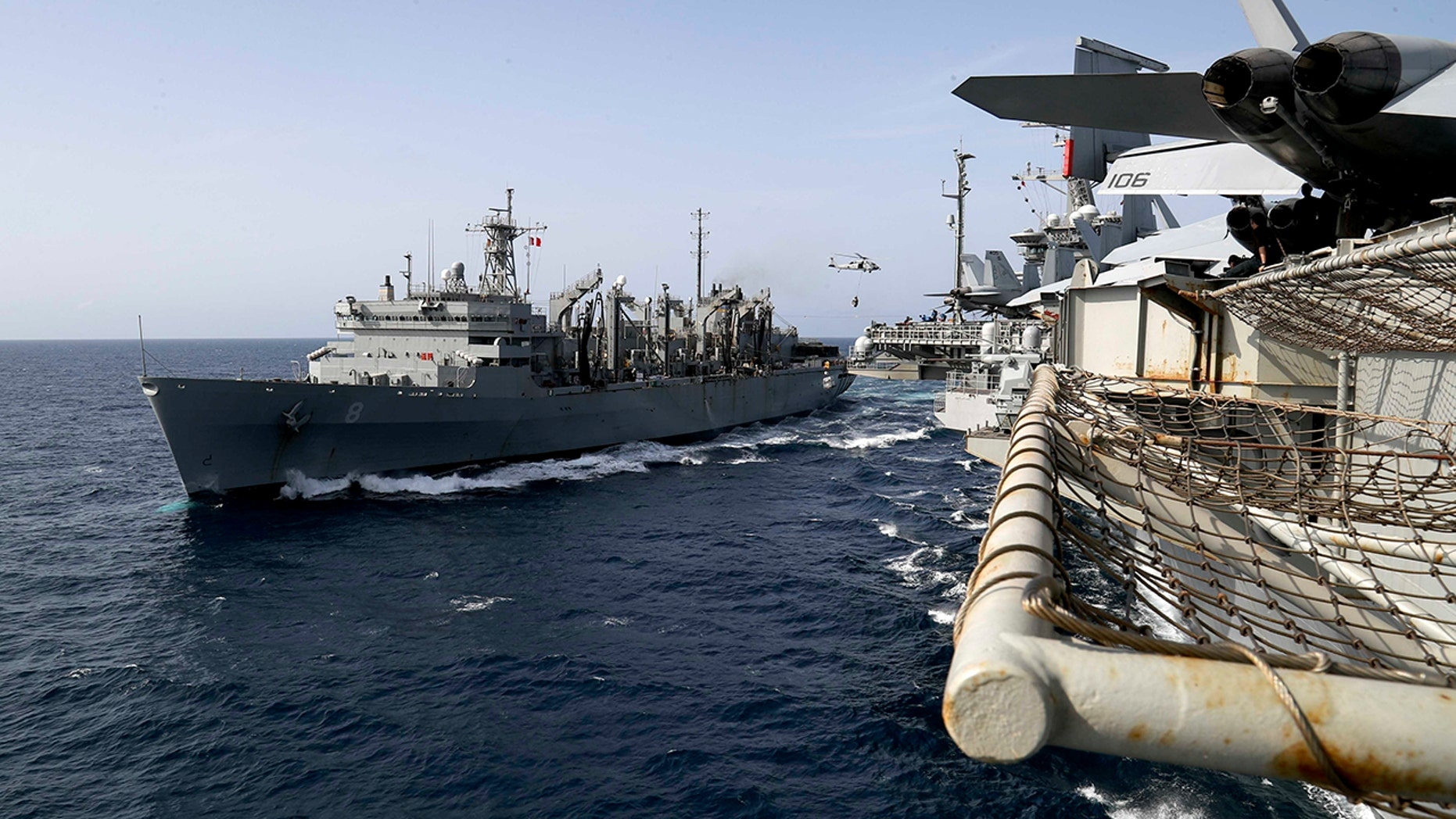 May 19: The fast combat support ship USNS Arctic transports cargo to the Nimitz-class aircraft carrier USS Abraham Lincoln during a replenishment-at-sea in the Arabian Sea. (Mass Communication Specialist 3rd Class Jeff Sherman/U.S. Navy via AP)