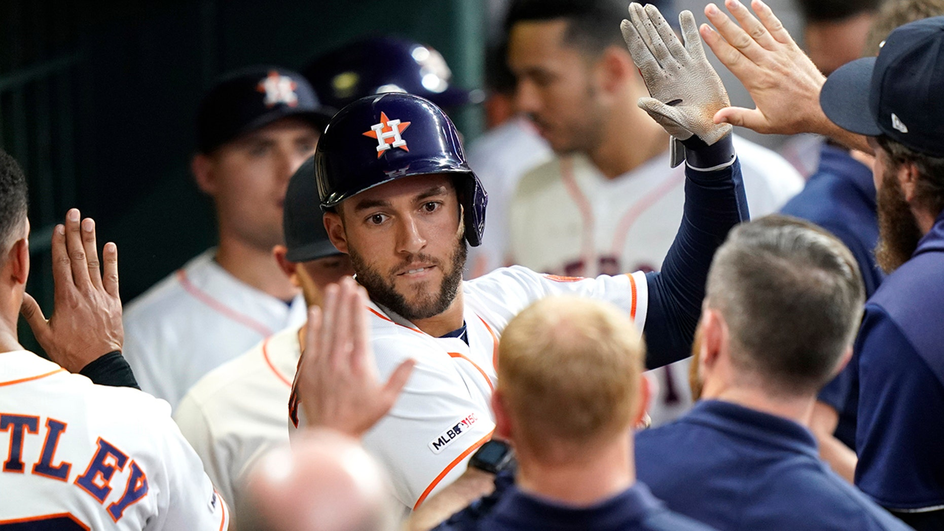 Houston Astros' George Springer is congratulated in the dugout after hitting a home run against the Cleveland Indians during the third inning of a baseball game Thursday, April 25, 2019, in Houston. (AP Photo/David J. Phillip)