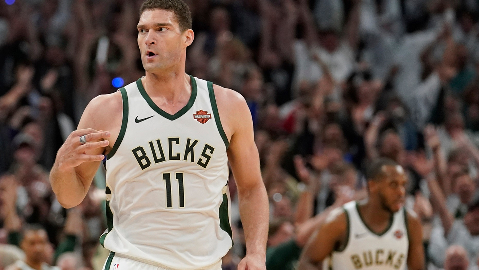 Milwaukee Bucks' Brook Lopez reacts to his three-point basket during the second half of Game 1 of the NBA Eastern Conference basketball playoff finals against the Toronto Raptors Wednesday, May 15, 2019, in Milwaukee. The Bucks won 108-100 to take a 1-0 lead in the series. (AP Photo/Morry Gash)