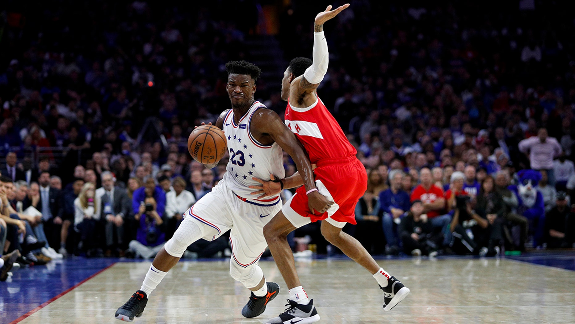 Philadelphia 76ers' Jimmy Butler, left, tries to get past Toronto Raptors' Patrick McCaw during the first half of Game 6 of a second-round NBA basketball playoff series Thursday, May 9, 2019, in Philadelphia. (AP Photo/Chris Szagola)