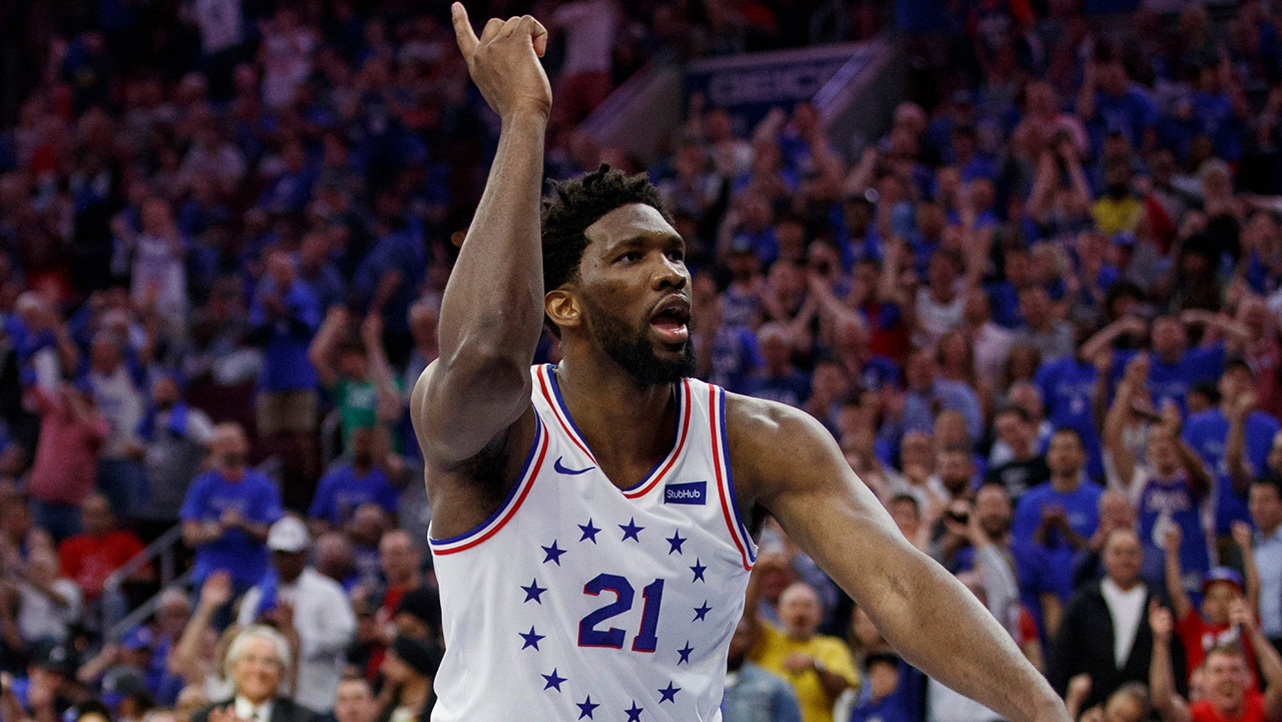 825756fe9927 Philadelphia 76ers  Joel Embiid reacts to his dunk during the second half  of Game 3
