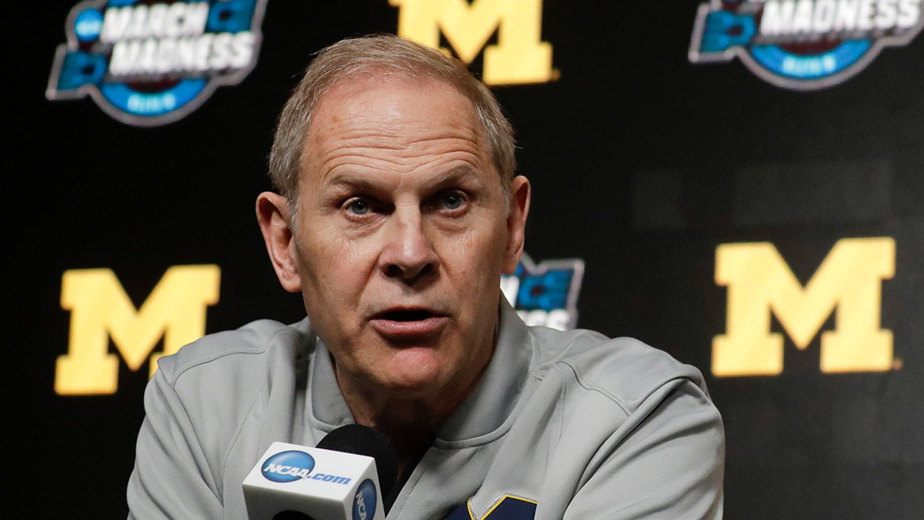 FILE - In this March 27, 2019 file photo Michigan head coach John Beilein speaks during a news conference at the NCAA college basketball tournament in Anaheim, Calif. (AP Photo/Chris Carlson, file)