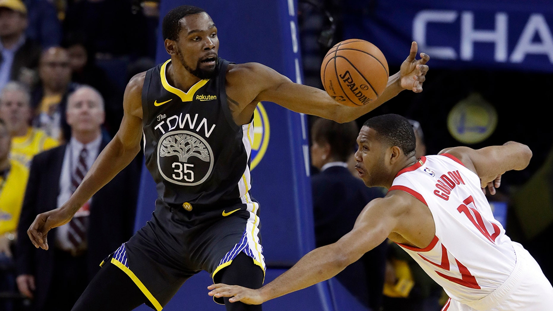 Golden State Warriors' Kevin Durant (35) is defended by Houston Rockets' Eric Gordon during the first half of Game 2 of a second-round NBA basketball playoff series in Oakland, Calif., Tuesday, April 30, 2019. (AP Photo/Jeff Chiu)