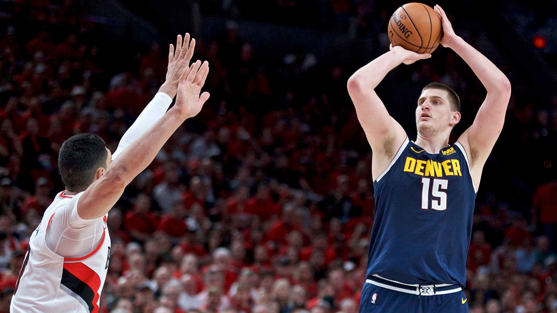 Denver Nuggets center Nikola Jokic, right, looks to shoot over Portland Trail Blazers center Enes Kanter during the first half of Game 4 of an NBA basketball second-round playoff series Sunday, May 5, 2019, in Portland, Ore. (AP Photo/Craig Mitchelldyer)