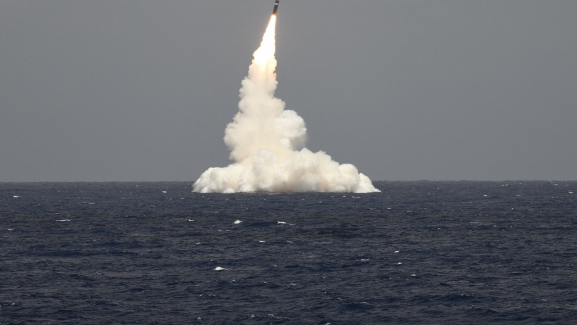 File photo - An unarmed Trident II D5 missile launches from the Ohio-class ballistic missile submarine USS Rhode Island (SSBN 740) off the coast of Cape Canaveral, Florida, May 9, 2019. (U.S. Navy photo by John Kowalski/Released)