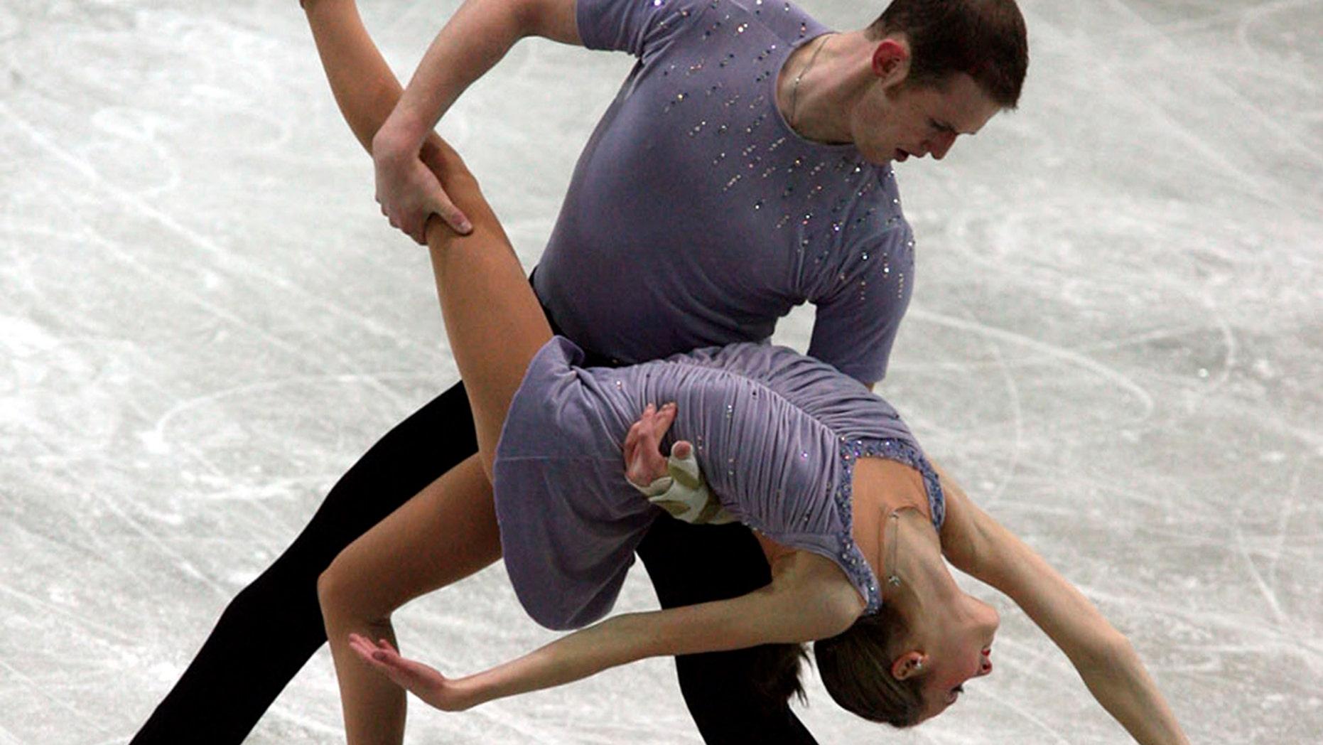 FILE - In this Dec. 8, 2006, file photo, Bridget Namiotka and John Coughlin perform during the ISU Junior Grand Prix of Figure Skating Final in Sofia, Bulgaria. (AP Photo/File)