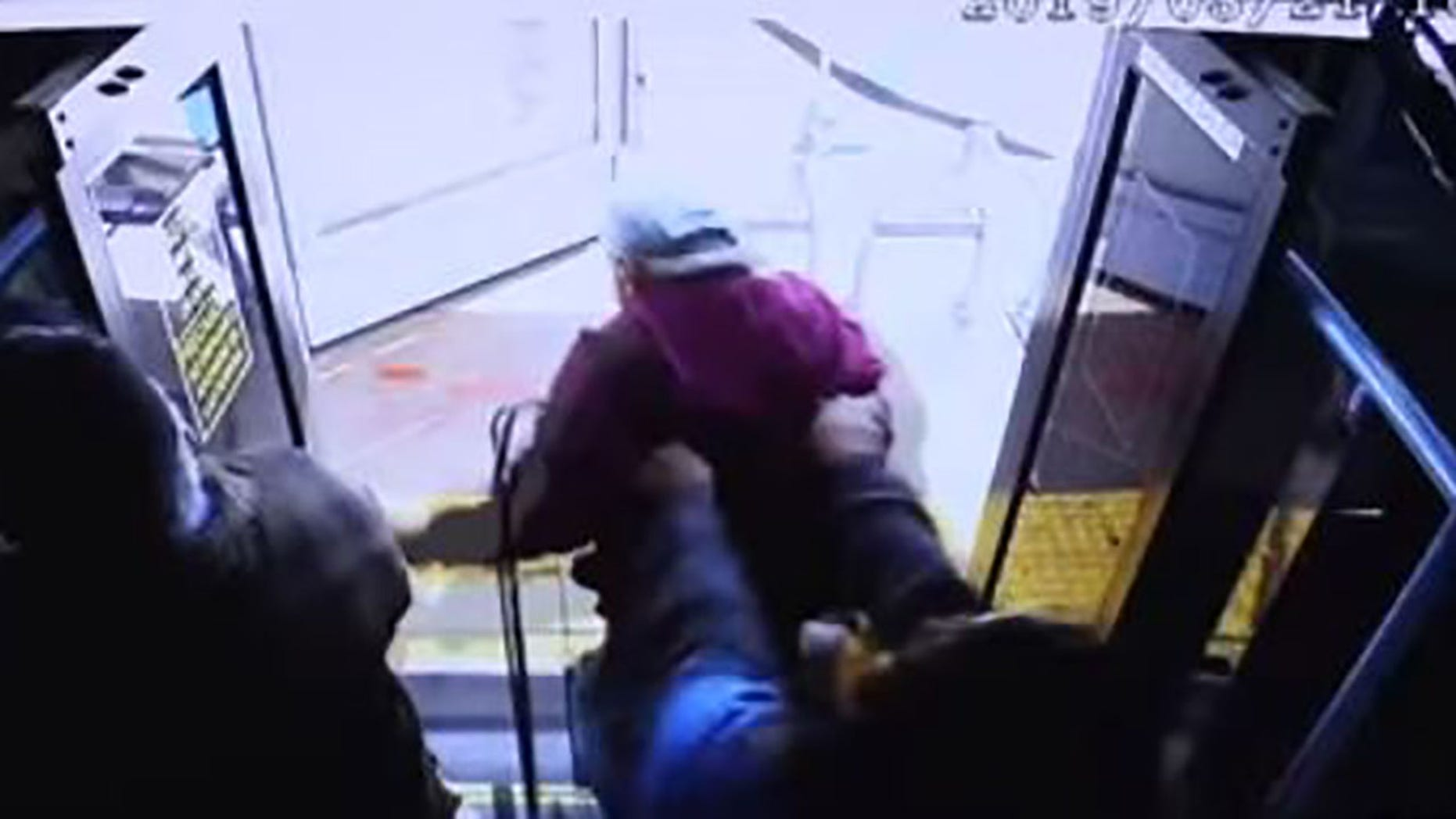 The surveillance video shows Bishop allegedly push Fournier out of the door of the stopped bus