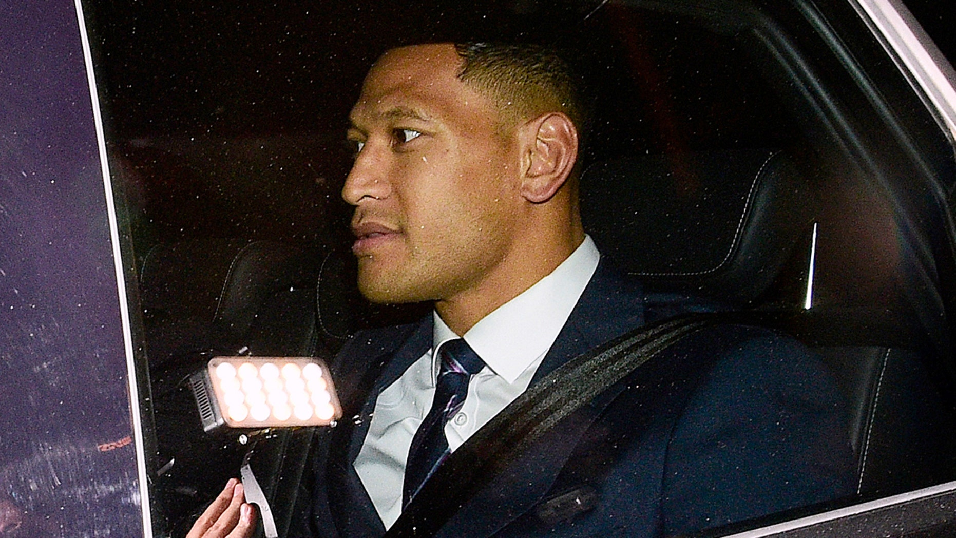 """Australian rugby union player Israel Folau leaves a Code of Conduct hearing in Sydney, Sunday, May 5, 2019. The 30-year-old Folau appeared before the hearing to fight Rugby Australia's decision to terminate his contract after he posted in mid-April on social media that gay people, along with other """"sinners,"""" will face damnation unless they repent. (AAP Image/Bianca De Marchi)"""