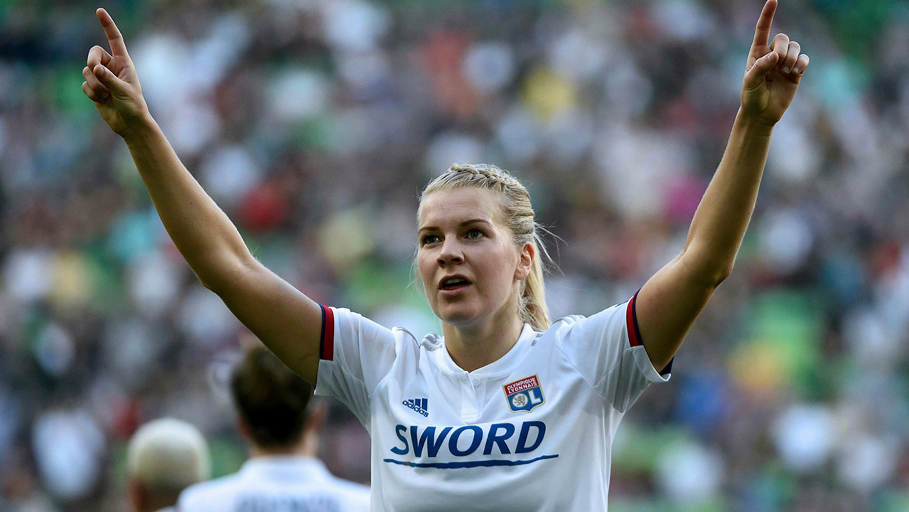 Ada Hegerberg of Lyon celebrates her idea during a women's soccer UEFA Champions League final compare between Olympique Lyon and FC Barcelona during a Groupama Arena in Budapest, Hungary, Saturday, May 18, 2019. (Balazs Czagany/MTI around AP)
