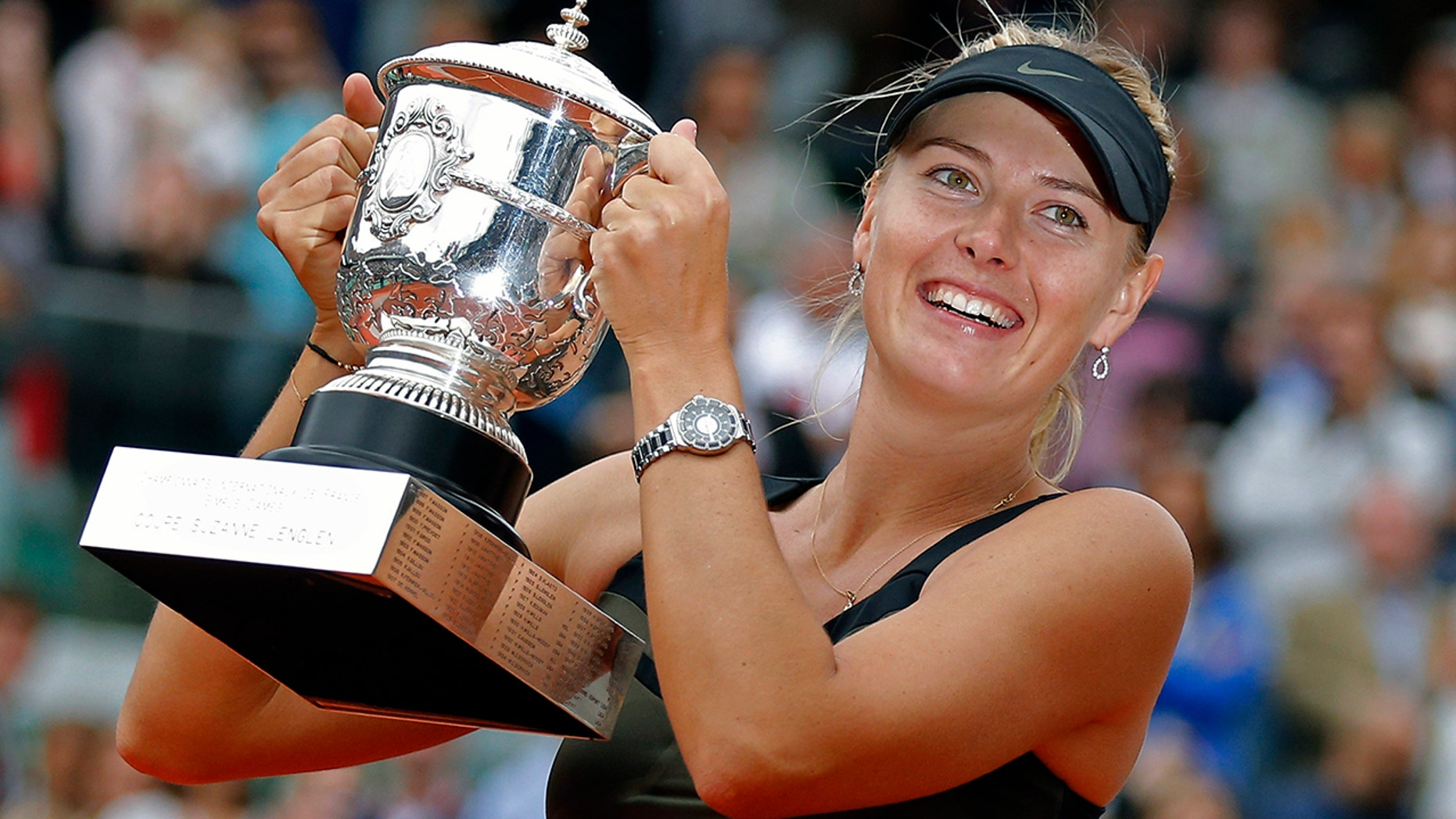 Maria Sharapova of Russia holds the trophy after winning the women's final match against Sara Errani of Italy at the French Open tennis tournament in Roland Garros stadium in Paris. (AP Photo/Michel Euler, File)