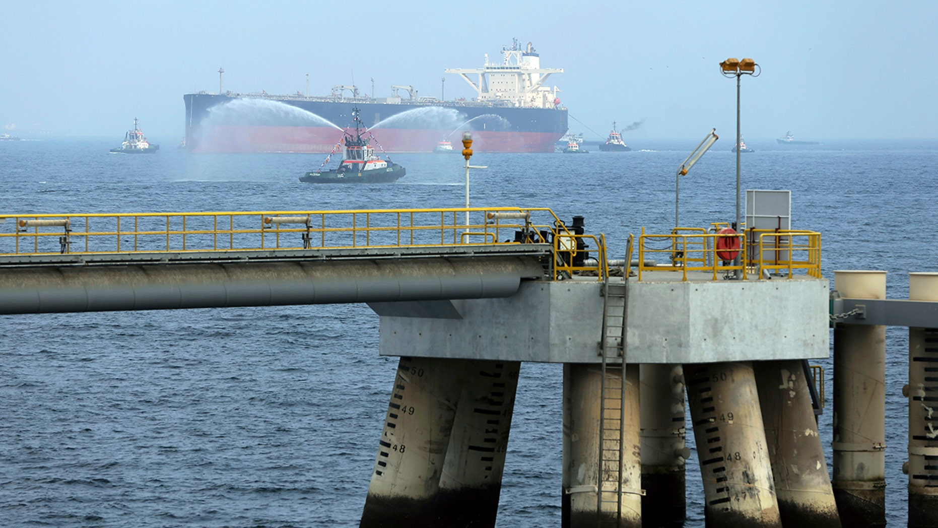 FILE - In this September 21, 2016 file photo, an oil tanker approaches the new bridge during the launch of the new $ 650 million oil plant in Fujairah, United Arab Emirates. (AP Photo / Kamran Jebreili)